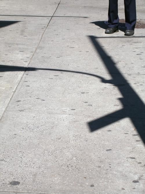 shadow on sidewalk, with legs, Manhattan, NYC