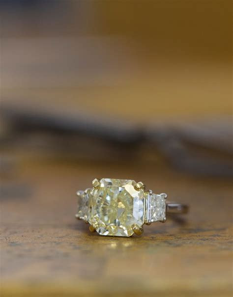 This one of a kind fancy yellow diamond engagement ring