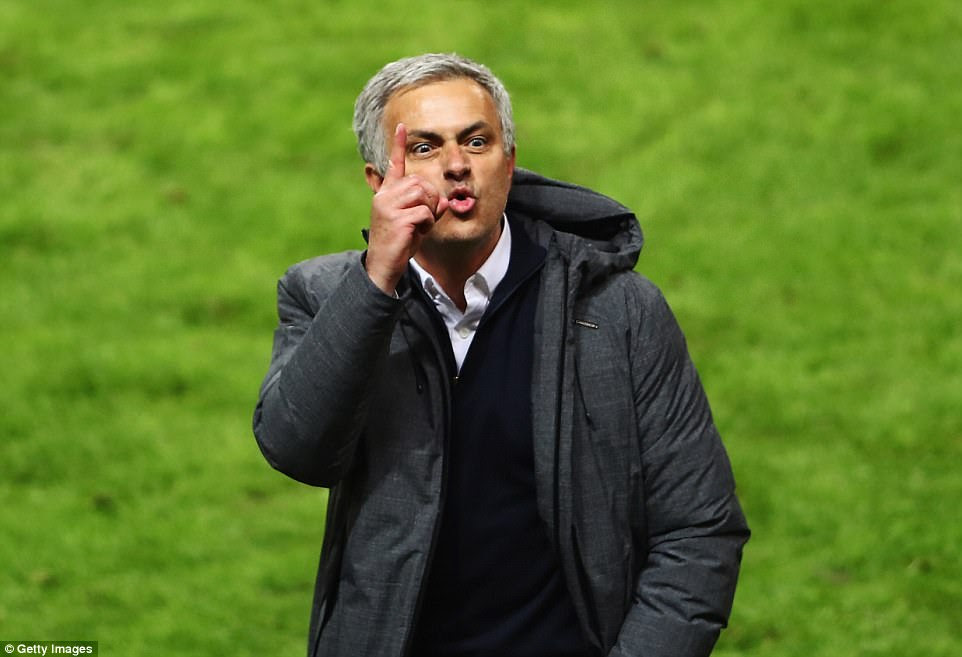 Mourinho performs a No 1 salute with his finger after leading the club to a Europa League triumph in his debut season at club