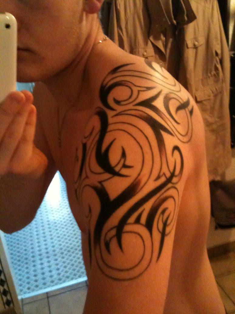 Left Shoulder Black Ink Tribal Tattoo For Men