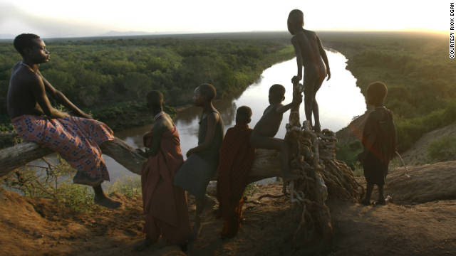 """Children from the Kara tribe gather near the Omo River at dawn. None of them are considered """"mingi."""""""