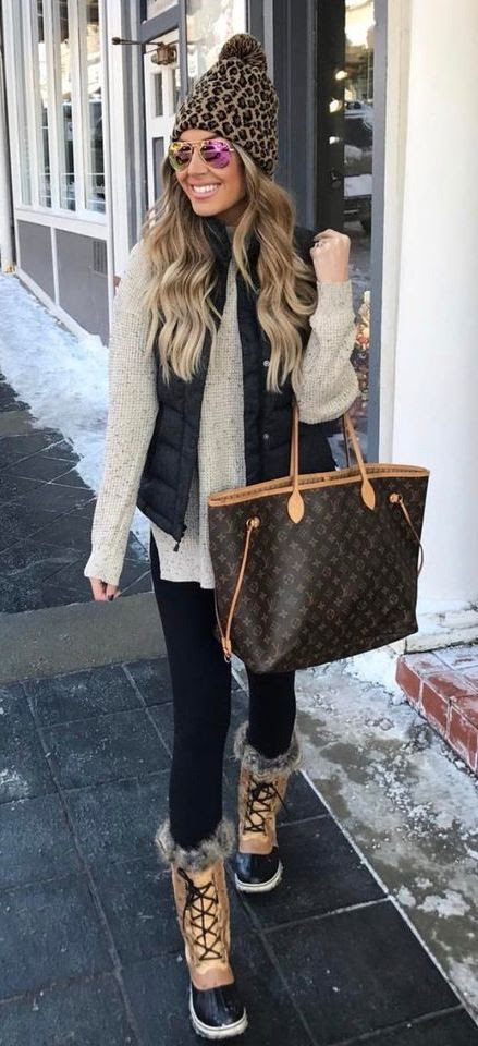 casual outfit idea / bag + nude sweater + knit hat + black vest + skinnies + boots