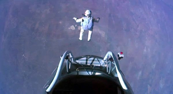 Austrian BASE jumper Felix Baumgartner leaps from the Red Bull Stratos space capsule to begin his 4-minute, 20-second freefall on October 14, 2012.