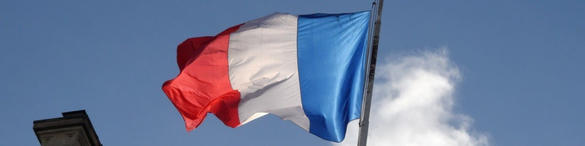The french flag flies at half mast at the Elysee Palace during a Unity rally Marche Republicaine on January 11, 2015 in Paris in tribute to the 17 victims of a three-day killing spree by homegrown Islamists. The killings began on January 7 with an assault on the Charlie Hebdo satirical magazine in Paris that saw two brothers massacre 12 people including some of the country's best-known cartoonists, the killing of a policewoman and the storming of a Jewish supermarket on the eastern fringes of the capital which killed 4 local residents. AFP PHOTO / DOMINIQUE FAGET (Photo credit should read DOMINIQUE FAGET/AFP/Getty Images)