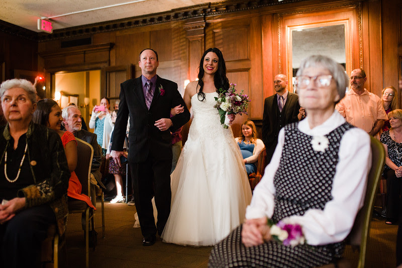 Photos of Sarah and Jean-Pauls indoor wedding ceremony at the University Club in downtown Rockford IL on a beautiful spring day.
