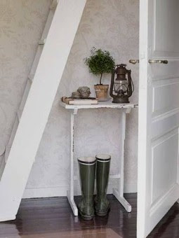 White end table, ladder and green rain boots via citified