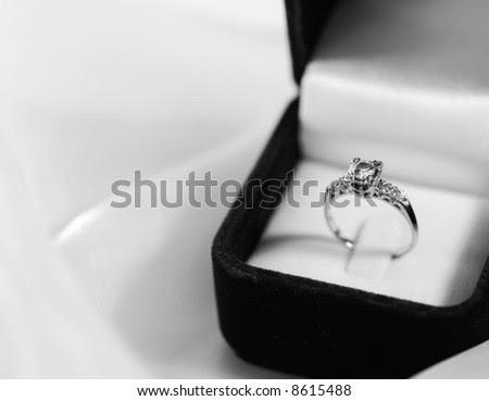 stock photo Black white engagement ring in a velvet box