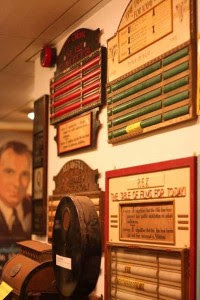 Selection of show time boards and other items on display in the museum