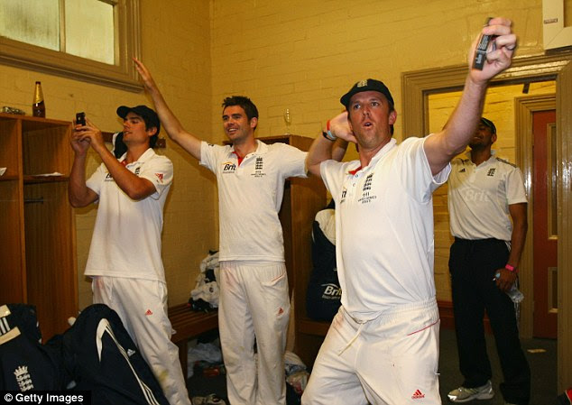 Sprinkling of magic: Graeme Swann celebrates in the dressing room by doing the now famous 'sprinkler' dance, while Cook and James Anderson look on