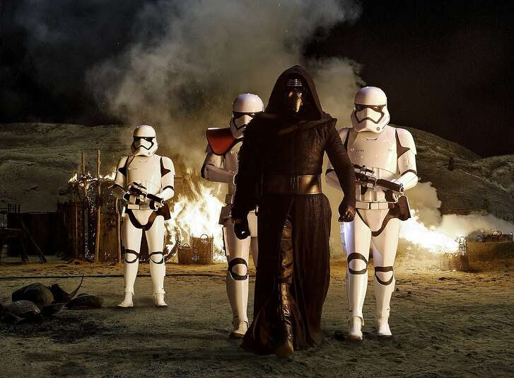 Kylo Ren (Adam Driver) with Stormtroopers From the new Disney/Lucasfilm production ÒStar Wars: The Force Awakens.