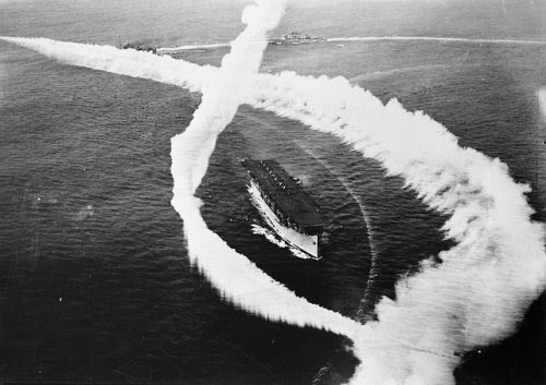 1927 - the USS Langley (CV-1) is practicing maneuvers with a smokescreen. Named after American astronomer, physicist, inventor, and aviation pioneer Samuel Langley, it was the US Navy's first aircraft carrier.  Photo from the J.M.F. Haase collection.