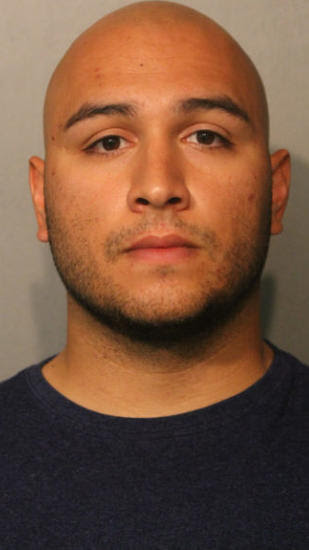 Man charged in attack against security guard