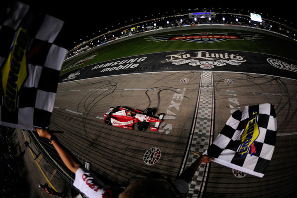 Justin Wilson of England, driver of the #18 Sonny's BBQ Honda Dallara, races to the checkered flag to win the IZOD IndyCar Series Firestone 550 at Texas Motor Speedway on June 9, 2012 in Fort Worth, Texas.