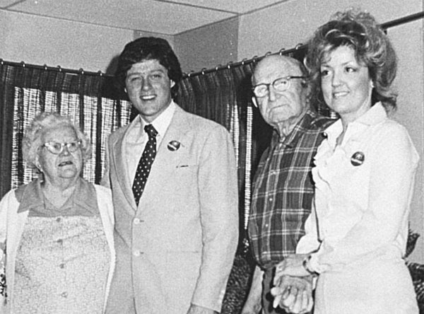 Juanita Broaddrick, right, with residents of her Arkansas retirement home and Bill Clinton in April 1978, the same month she says Clinton raped her