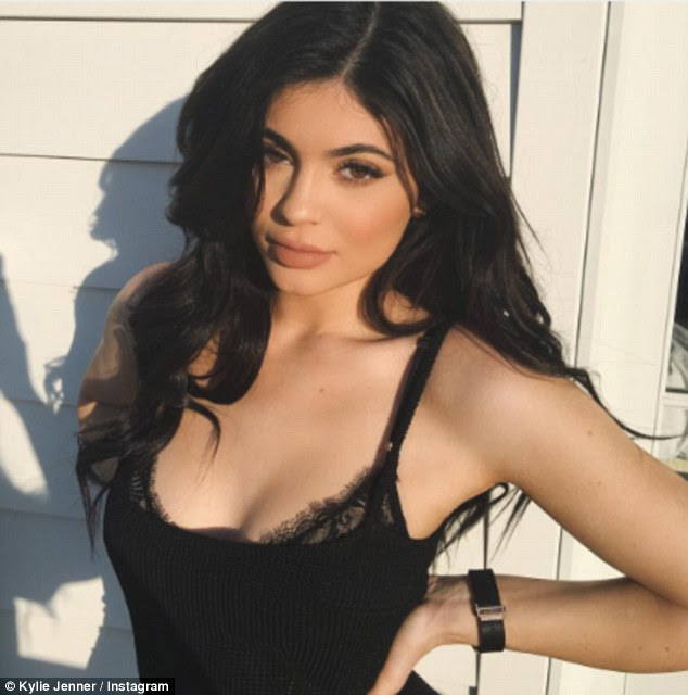 Cleavage: The provocative picture will certainly make sure her new rumoured beau would pay attention, after she complained last Thursday that he 'hides' her