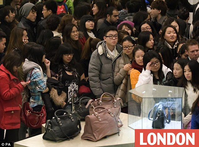 Out to bag a bargain: Young, mainly Far Eastern shoppers survey the goods at Selfridges in Central London