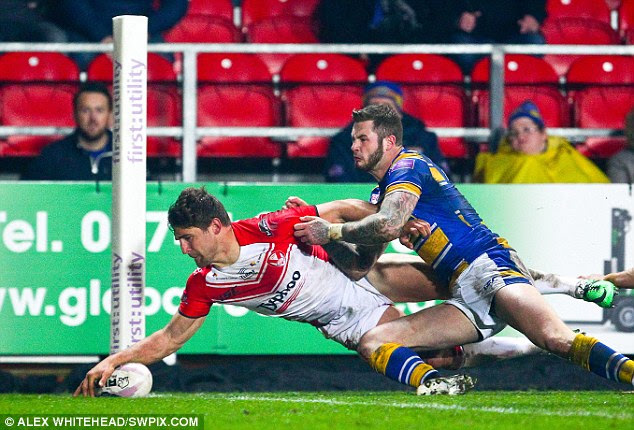 Double trouble: St Helens' Tom Makinson crossed twice, including this late finish in the corner to defeat Leeds