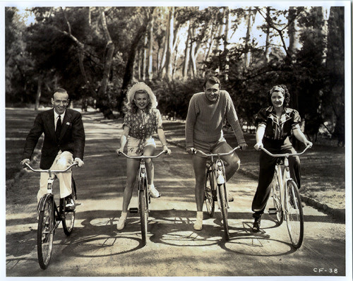 Fred Astaire, Ginger Rogers, Ralph Bellamy and Luella Gear ride bikes.