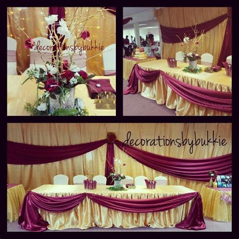 Gold and burgundy backdrop for a 50th birthday. Head table