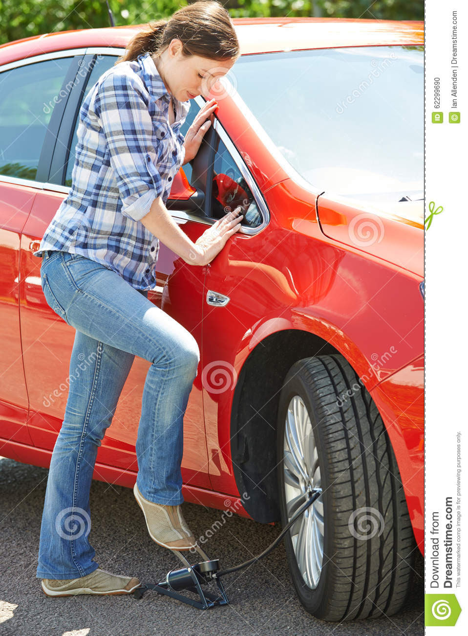 Woman Inflating Car Tyre With Foot Pump Stock Photo Image 62299690
