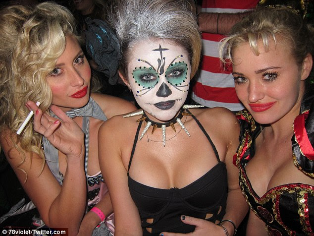Disney reunion: Miley Cyrus dressed up as some kind of sexy creature as she attended Amanda and Alyson Michalka's Halloween party