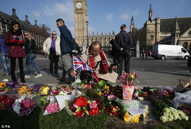 Mourners have continued to lay floral tributes in Parliament Square today, pictured, to remember the victims of the heinous attack