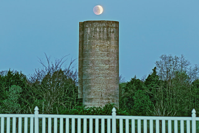 A partial phase for the April 4th lunar eclipse above a silo. Image credit and copyright: Brian who is called Brian