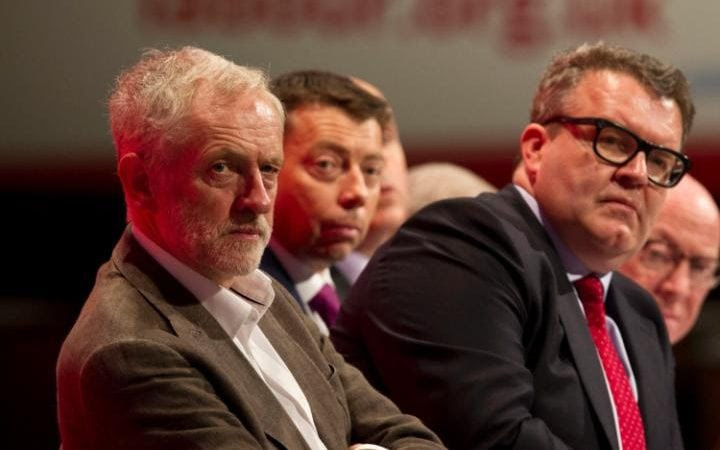 Jeremy Corbyn, Tom Watson and others on the platform listen to speakers on the first day of the Labour Party Conference
