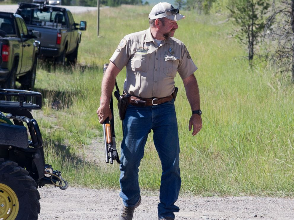 PHOTO: Montana Fish, Wildlife and Parks game warden Perry Brown prepares to hunt for a grizzly bear that killed Forest Service law enforcement officer Brad Treat near West Glacier, Mont. on Wednesday, June 29, 2016.