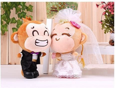 a pair of cute small wedding dress monkey toys lovers