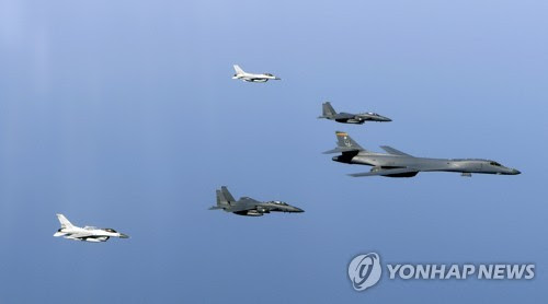 This photo, provided by South Korea's Air Force on March 22, 2017, shows a joint military drill staged by U.S. B-1B strategic bombers and South Korean KF-16 fighter jets. (Yonhap)