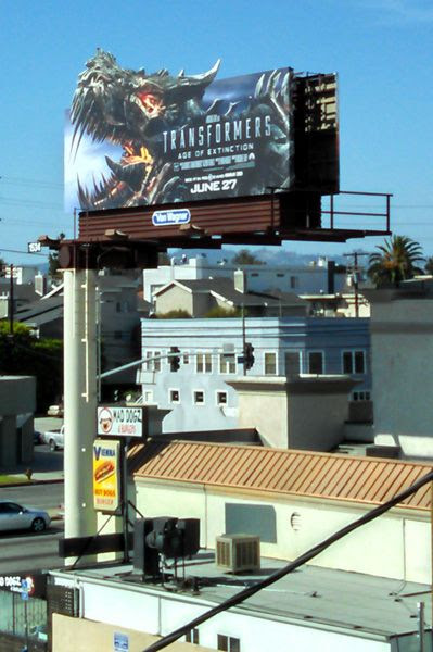 A billboard advertisement for TRANSFORMERS: AGE OF EXTINCTION in Culver City, California.