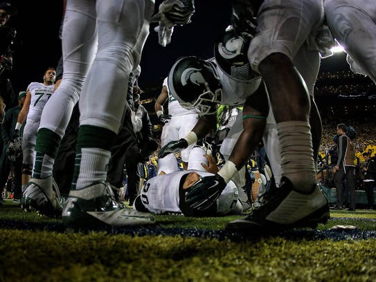 Teammates surround injured Michigan State defensive