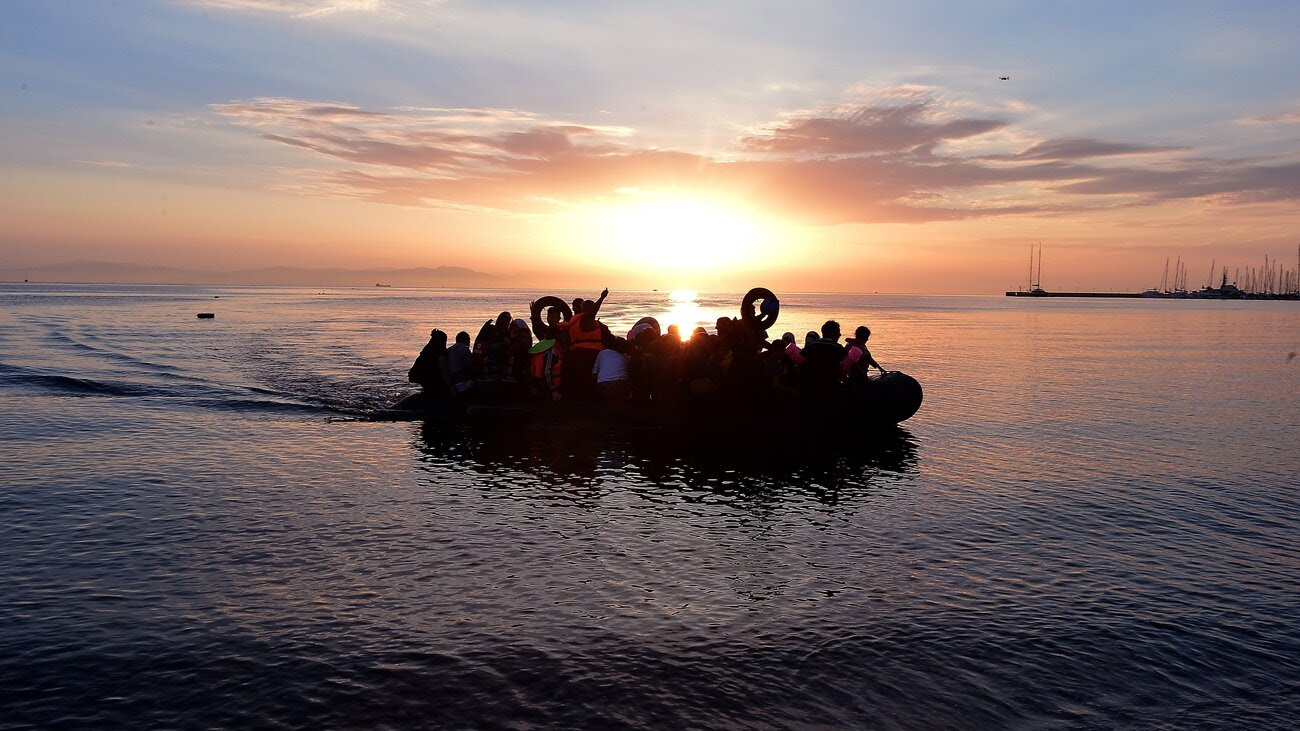 Syrian migrants arrive on an overcrowded dinghy to the coast of the southeastern Greek island of Kos from Turkey, on Saturday. A ferry boat has been sent by the Greek government to the resort of Kos to speed up the registration process of hundreds of Syrian refugees.