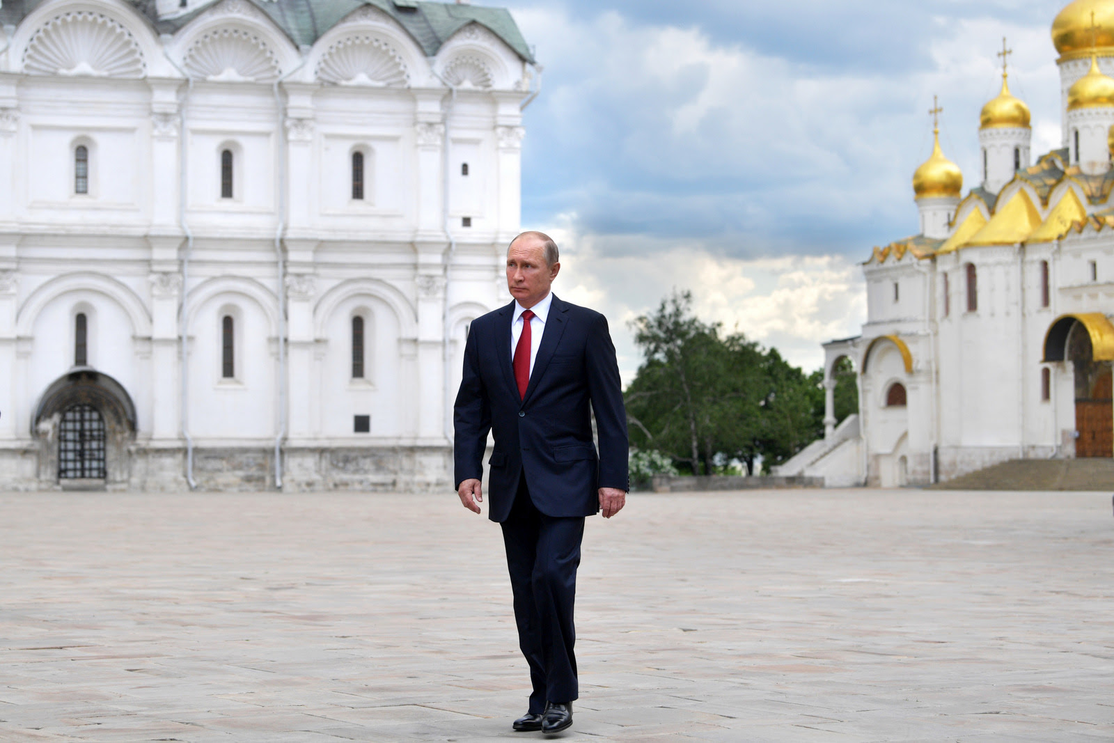Russian President Vladimir Putin walks along the Cathedral Square of the Kremlin, to take part in a holiday reception in Moscow, Monday, June 12, 2017. (Alexei Druzhinin/Sputnik)