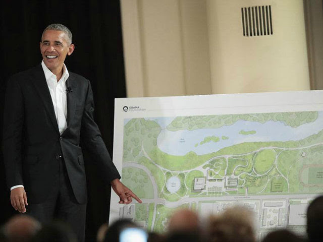 Former President Barack Obama points out features of the proposed Obama Presidential Center, which is scheduled to be built in nearby Jackson Park, during a gathering at the South Shore Cultural Center on May 3, 2017 in Chicago, Illinois. The Presidential Center design envisions three buildings, a museum, library and …