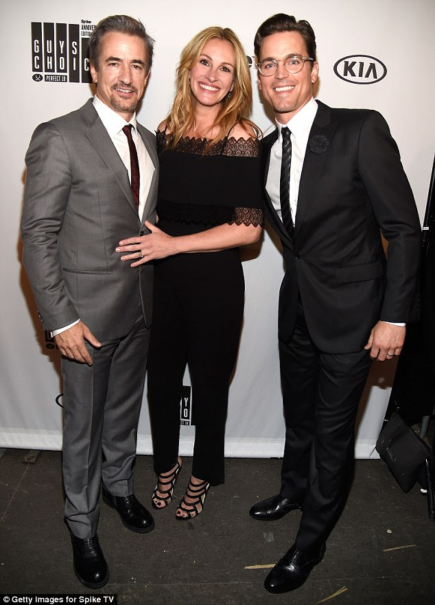 Impressive: She shot to fame after starring in the romantic comedy Pretty Woman in 1990 and went on to win an Academy Award for Best Actress award for the 2001 flick Erin Brockovich. -Pictured with Dermot Mulroney (L) and Matt Bomer (R)