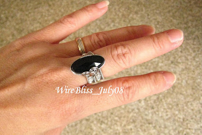 wire wrapped adjustable black onyx rings on my finger