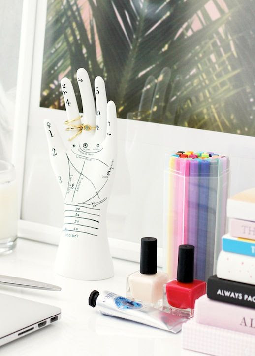 Le Fashion Blog Stylish Whimsical Work Space Urban Outfitters Hand Jewelry Ring Holder Nude And Red Nail Polish Hand Lotion Office Decor