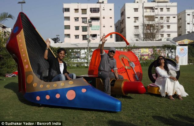 Fashion accessories: Mr Yadav with his family in cars shaped like a shoe, a bag, a make-up compact and lipstick
