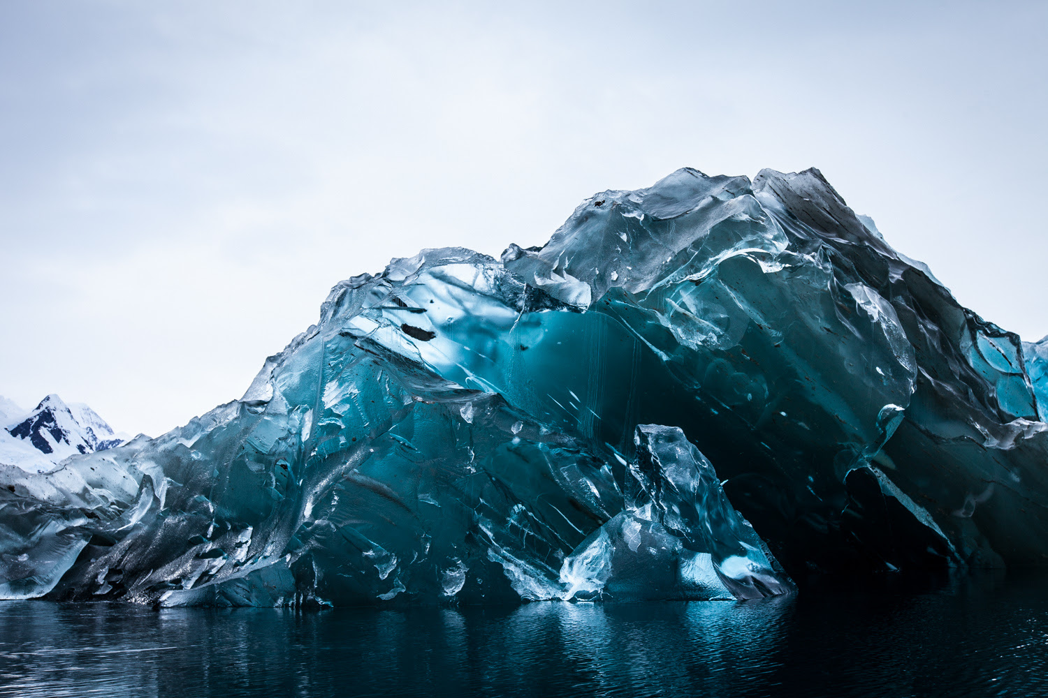 http://www.thisiscolossal.com/2015/01/a-rare-flipped-iceberg-in-antarctica-photographed-by-alex-cornell/