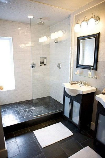 Small bathroom - White subway tile with dark square floor ...