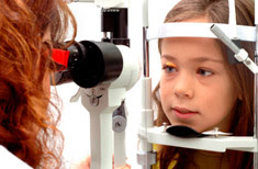 Young girl getting eyes checked at the eye doctor