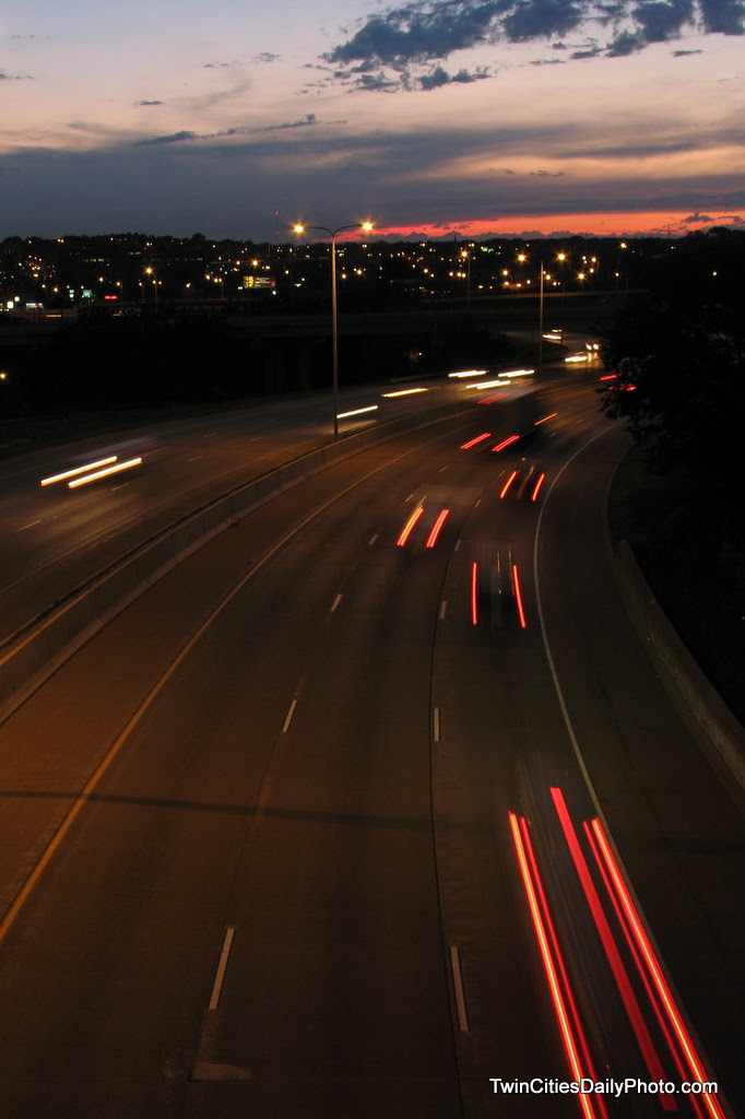 On the overpass of Interstate 94, near Mounds Boulevard in St Paul, traffic whizzes under my camera lens at light speed.