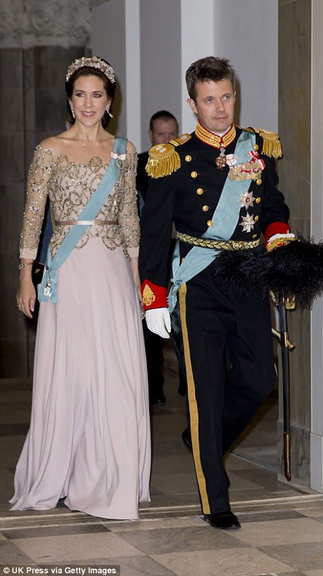 Making an entrance: Queen Margrethe (left) and Crown Prince Frederik and his wife Mary (right)