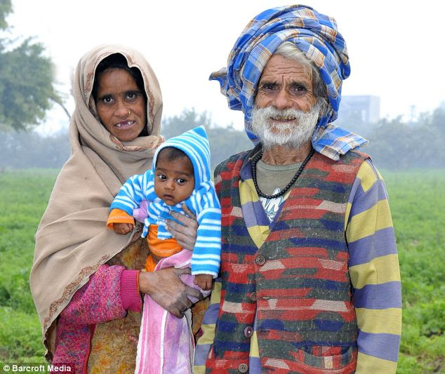 Family: Ramjit and Shankuntala pictured with their oldest son Karamjit in 2010 when Ramjit was named the world's oldest father the first time