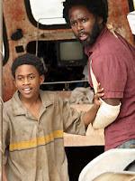 Lost - Malcolm David Kelley as Walt and Harold Perrineau as Michael