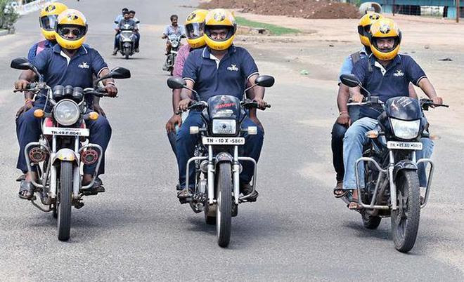 Bike taxi service (Rapido) seen ferrying passengers in Tiruchi.