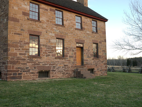Sunrise reflecting off of windows of Old Stone House at Manassas National Battlefield, Virginia.