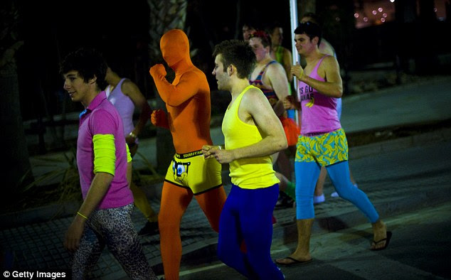 Riot of colour: There's no missing these Brits abroad as they pull on garish tones and leggings for a debauched night in the Catalan village